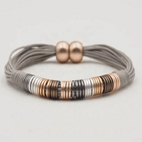 Abella Grey Cord Cuff Bracelet with silver pewter gold and rose gold beads and rose gold clasp